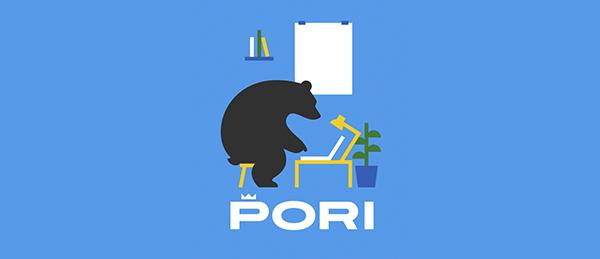 Kuvassa on Porin kaupungin logo ja musta karhu tietokoneen ääressä. Kuva on koriste.
